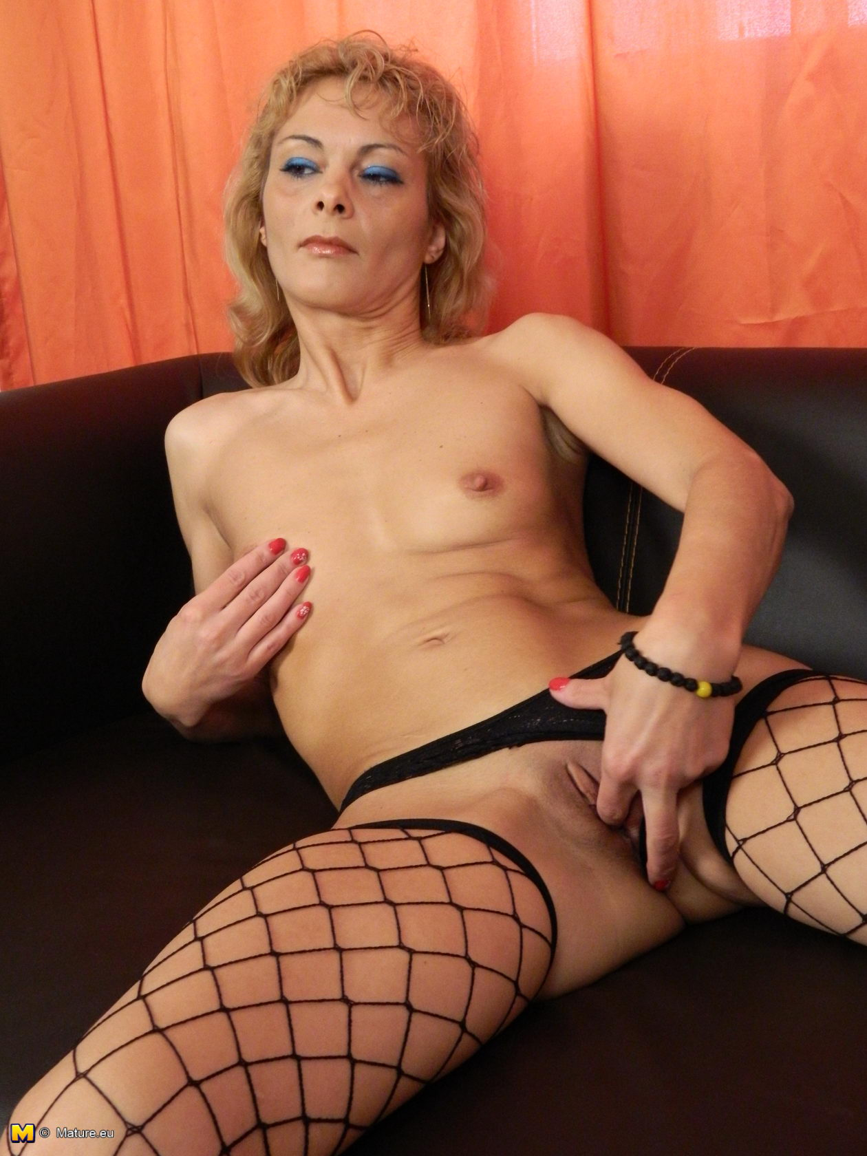 skinny blonde woman grabs her shaved hole