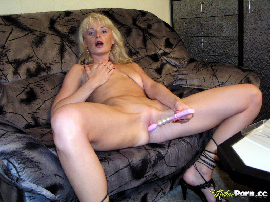 blonde amateur mom plays with her new sex toy