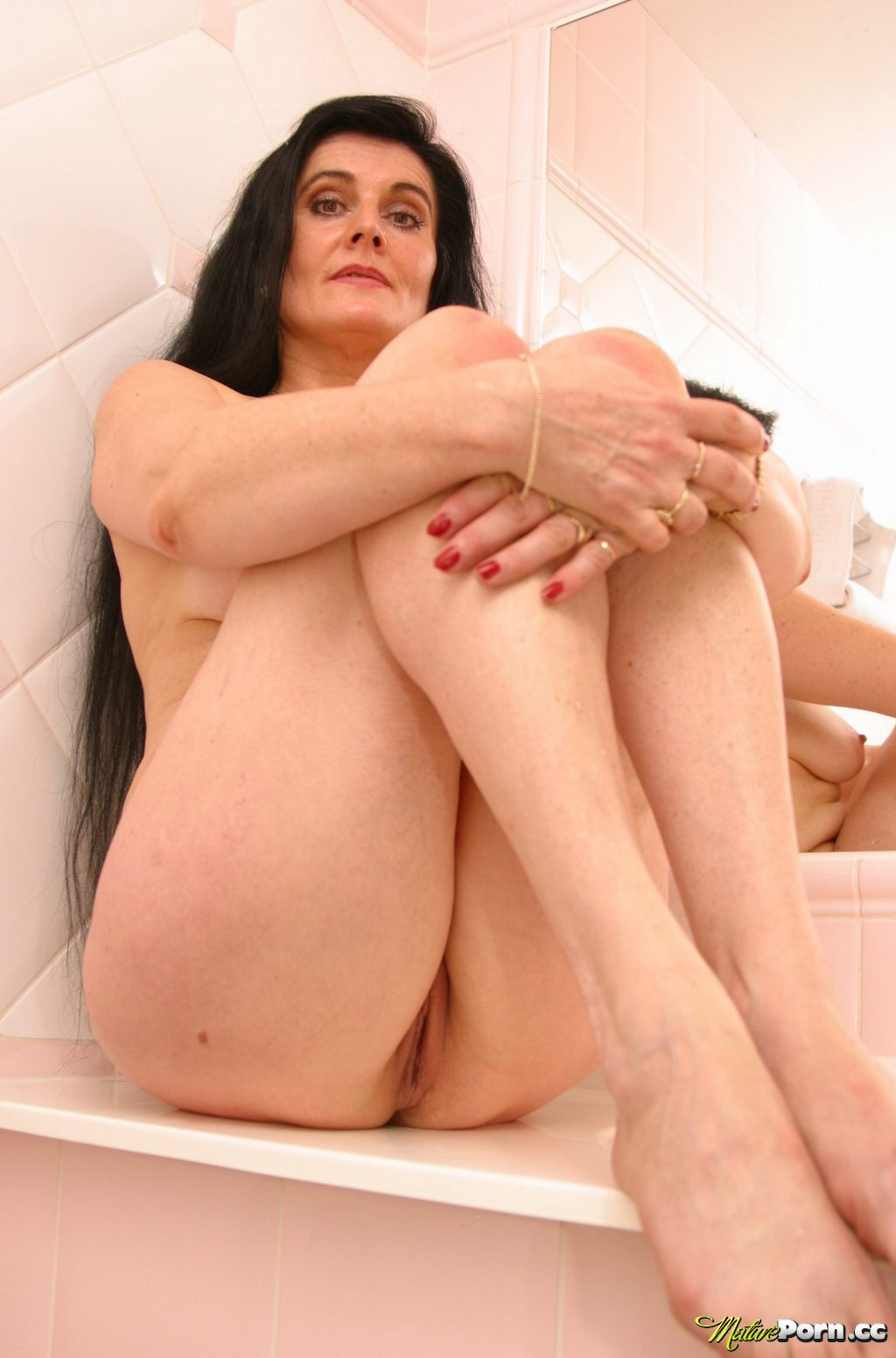 Brunette shaved pussy mature