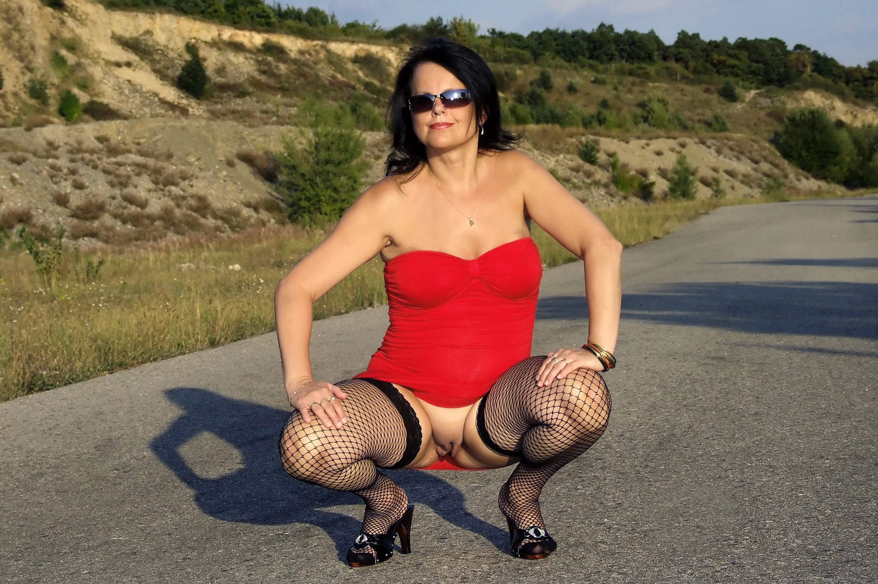 Mature flashing outdoors one sexy